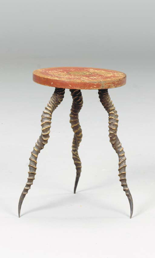 A TRIPOD FORM HORN LOW TABLE,