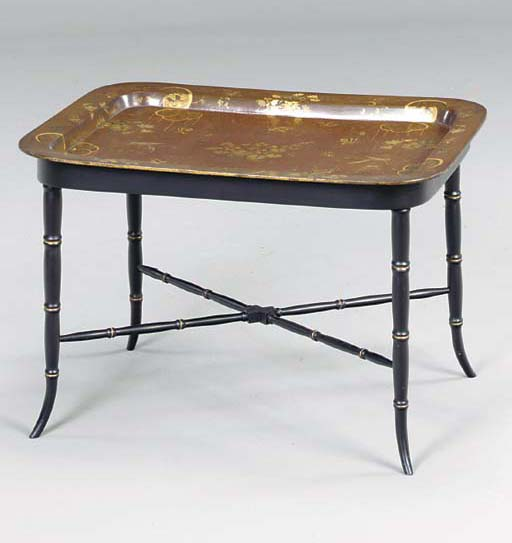A VICTORIAN BROWN AND GILT TOL