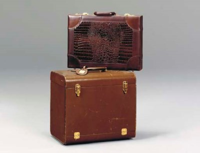 A GROUP OF EIGHT BRIEFCASES, S