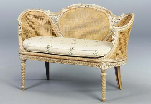 A LOUIS XV STYLE CANED SETTEE