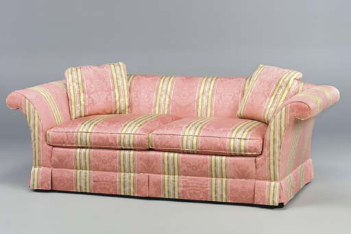 A SOFA UPHOLSTERED IN ROSE AND