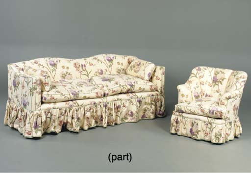 A CHINTZ UPHOLSTERED SOFA AND