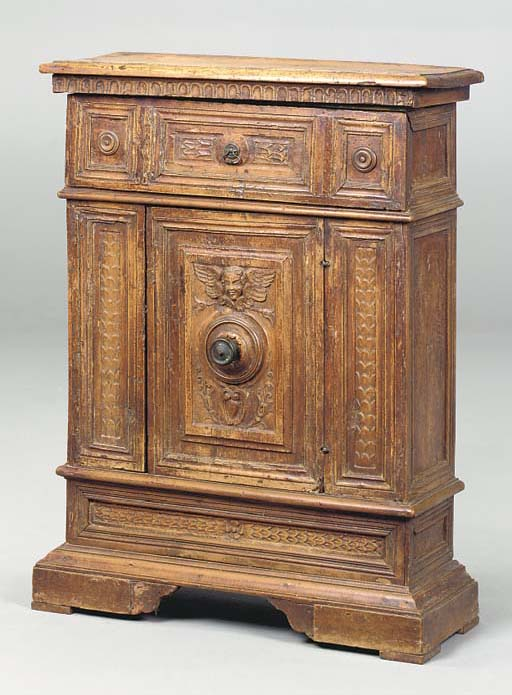 AN ITALIAN CARVED AND STAINED