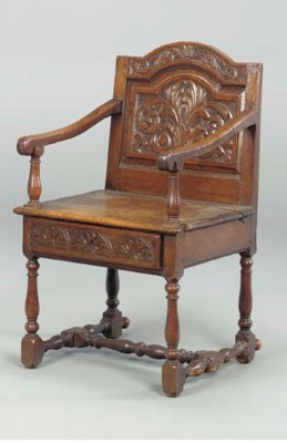 A JACOBEAN OAK CHAIR WITH DRAW