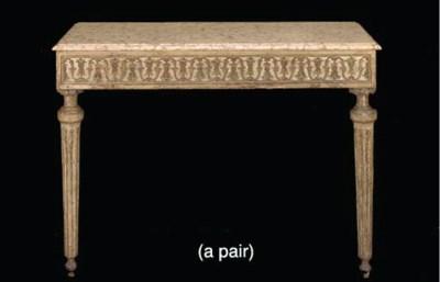 A PAIR OF ITALIAN CREAM-PAINTE