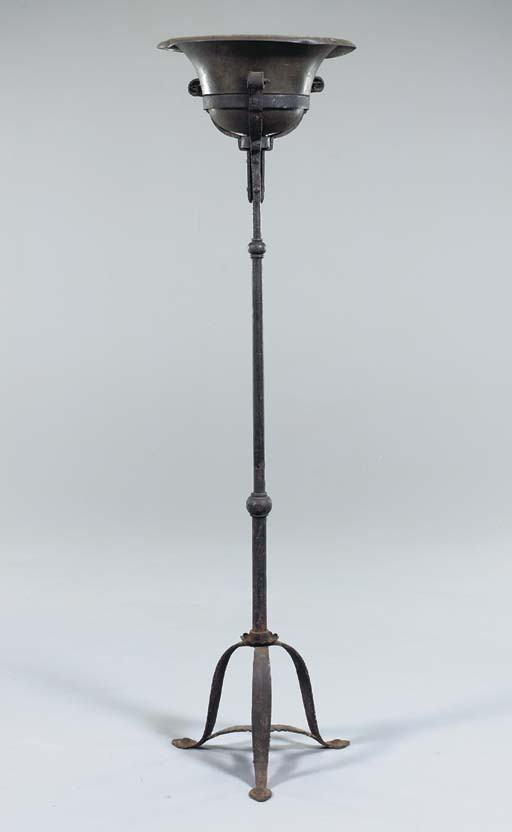 A WROUGHT IRON AND TOLE TORCHE