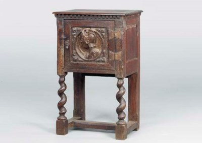 A FLEMISH OAK SIDE CABINET,