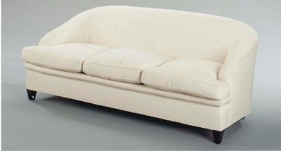 A WHITE UPHOLSTERED SOFA,