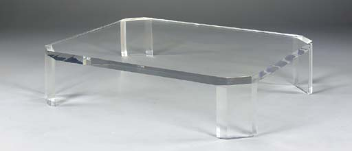 AN ACRYLIC LOW TABLE,