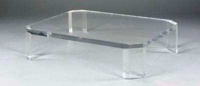 AN ACRYLIC LOW TABLE,