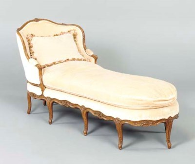 A LOUIS XV STYLE CARVED WALNUT