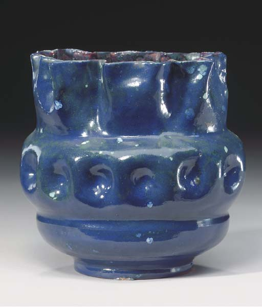 A GLAZED EARTHENWARE VASE