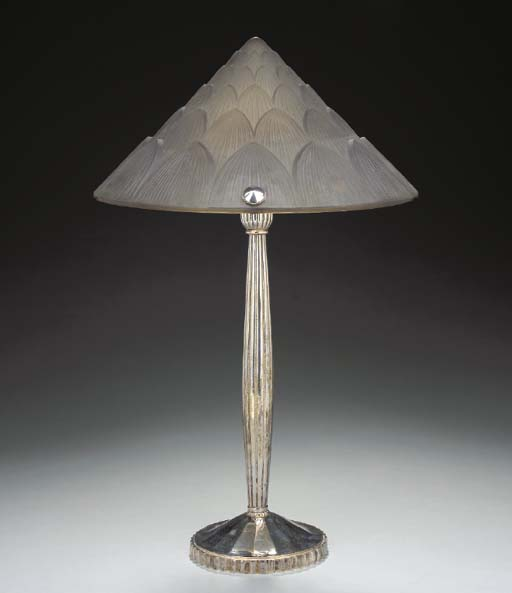 A MOLDED GLASS AND SILVERED-ME