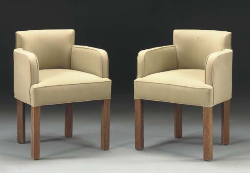 A PAIR OF LIMED OAK ARMCHAIRS