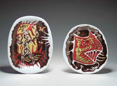 TWO GLAZED CERAMIC CHARGERS