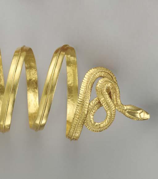 A PAIR OF GOLD SNAKE BRACELETS