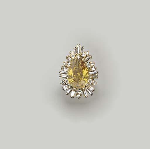 A TREATED YELLOW DIAMOND, DIAM