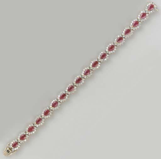 A PEAR-SHAPED RUBY, DIAMOND AN
