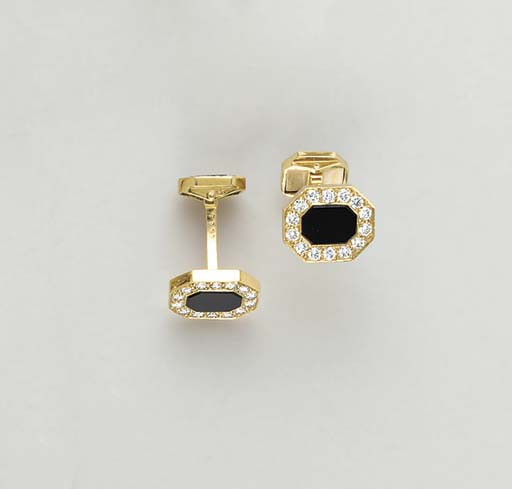 A PAIR OF ONYX, DIAMOND  AND 1
