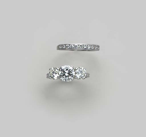 A THREE-STONE DIAMOND AND PLAT