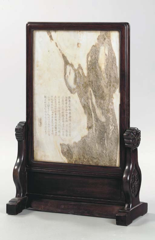 AN UNUSUAL INSCRIBED MARBLE AN