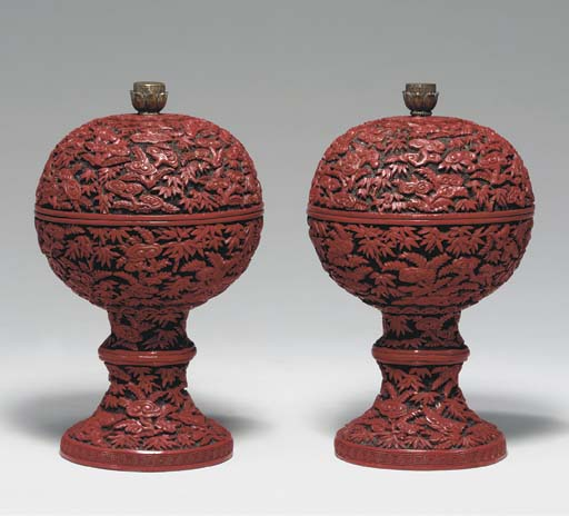 A RARE PAIR OF CARVED RED LACQ