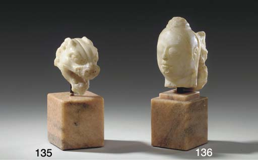 A SMALL WHITE MARBLE HEAD OF A