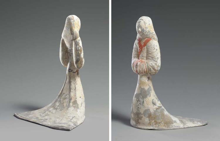 A PAINTED GREY POTTERY FIGURE