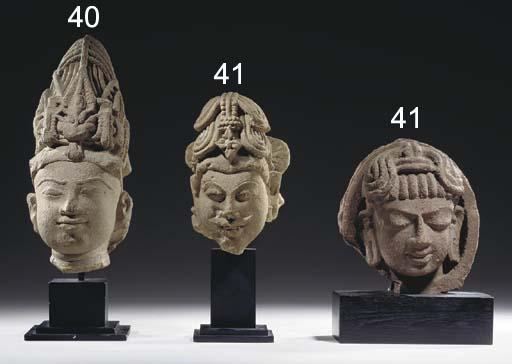 A Sandstone Head of Agni and a