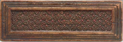A Carved and Polychromed Wood