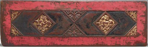 A Carved Painted and Gilt Wood