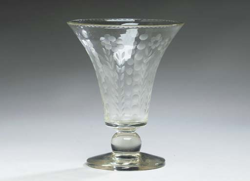 A CUT-GLASS VASE,