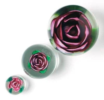 THREE ROSE PEDESTAL WEIGHTS,