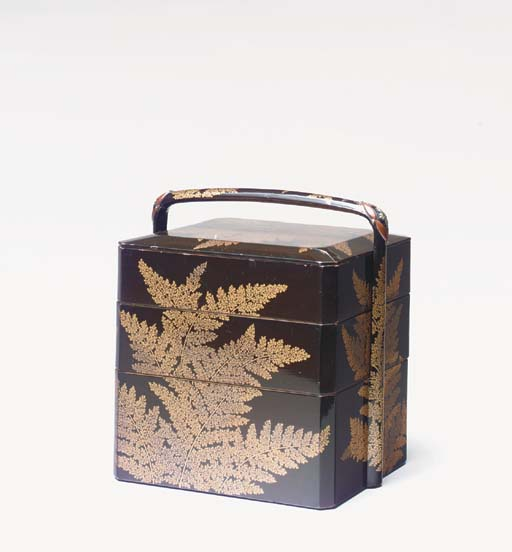 A THREE-TIER BLACK LACQUER BOX