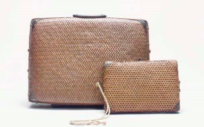 A BAMBOO CASE WITH A LONG STRA