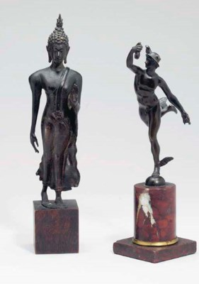 A GROUP OF SMALL BRONZE FIGURE