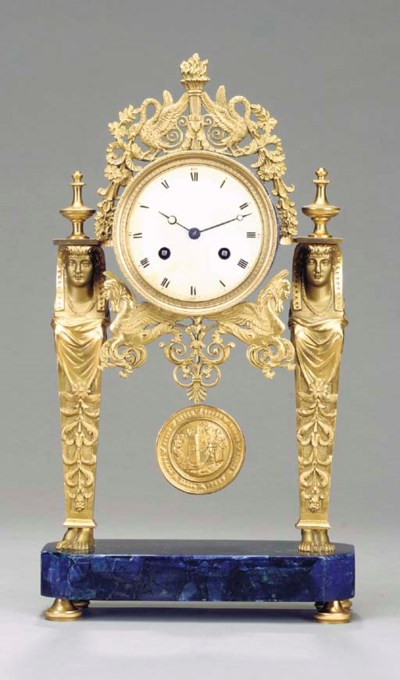 AN EMPIRE STYLE GILT-METAL AND