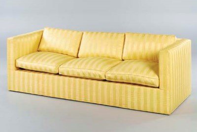 A SOFA UPHOLSTERED IN STRIPED