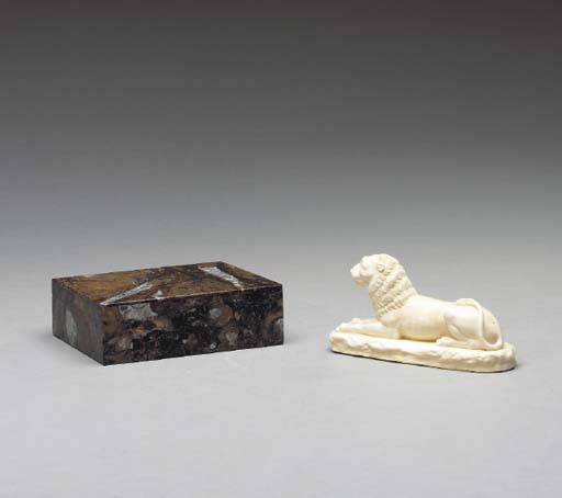 A CONTINENTAL CARVED IVORY FIG