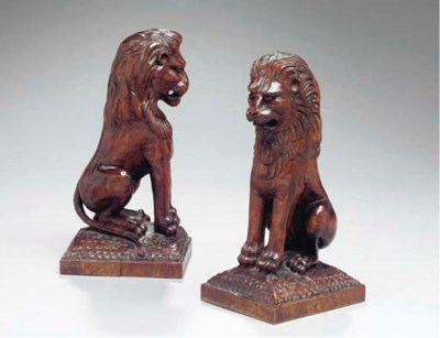 A PAIR OF CARVED WALNUT LION-F