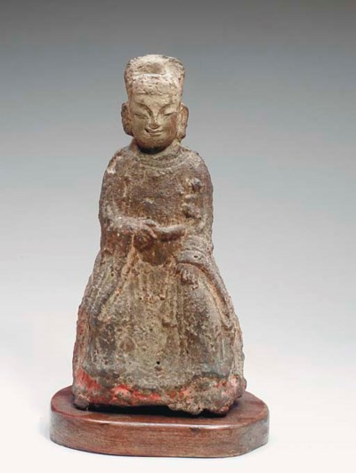 A CHINESE BRONZE FIGURE
