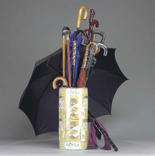 A GROUP OF UMBRELLAS AND WALKI