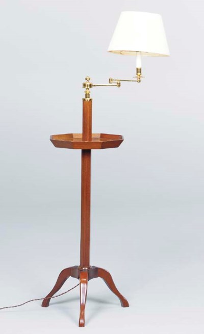 A PAIR OF MAHOGANY FLOOR LAMPS