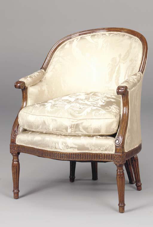 A LOUIS XVI STYLE WALNUT BERGE