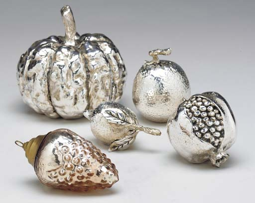 A GROUP OF SILVER-PLATED FRUIT