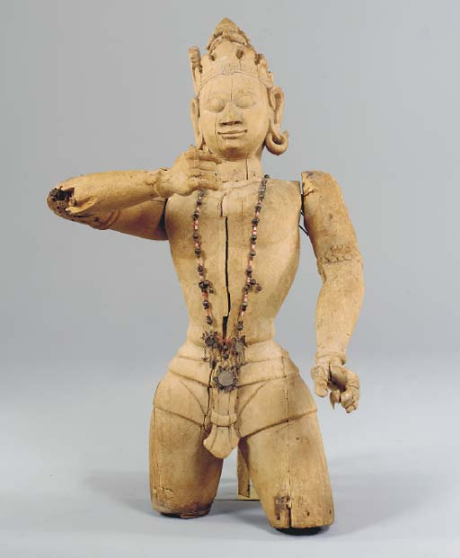 A CARVED WOOD FIGURE OF A BODH