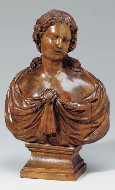 A CARVED BOXWOOD BUST OF A LAD