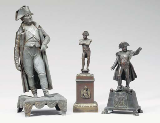 A GROUP OF FOUR PATINATED META