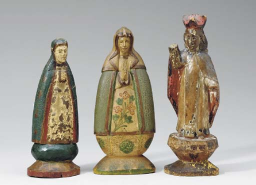 A GROUP OF SEVEN CARVED SANTOS