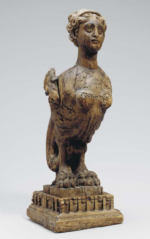 AN ITALIAN CARVED FIGURE OF A